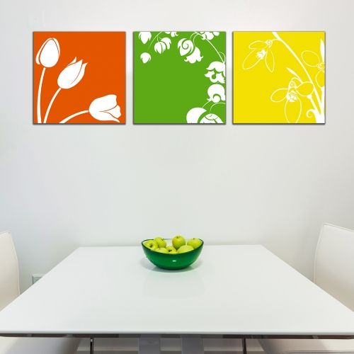 floral canvas wall art in green, orange and yellow