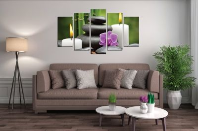 Zen canvas art composition with candles orchid and stones on green background